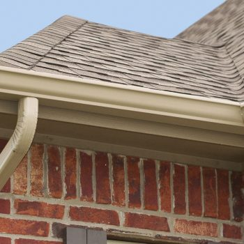 24597195 - house roof, gutters and downspout on the corner of a house
